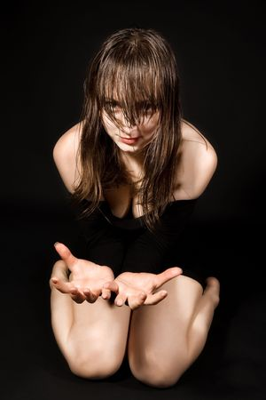 Woman with wet hair sitting on her knees Stock Photo - 6758426