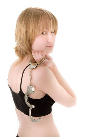 Woman with handcuffs thinking Stock Photo - 6869581