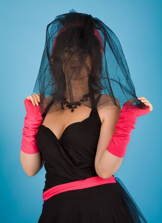 Girl in black dress with pink hat posing Stock Photo - 6869551