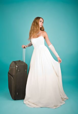 Picture of a bride with large suitcase Stock Photo - 6869560