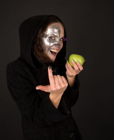 to tempt: Two-faced sorceress with green apple tempt