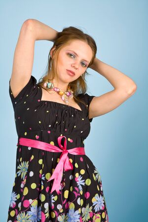 Young woman in colorful dress looking to the camera Stock Photo - 6967606