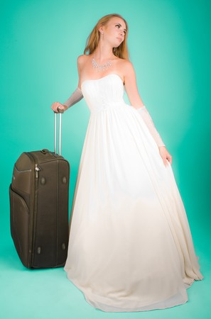 Bride with large suitcase looking to the camera Stock Photo - 6967570