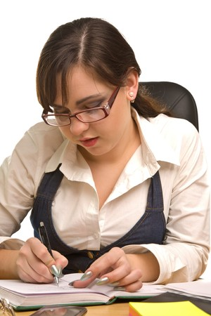 Young businesswoman with notebook in the office writting photo