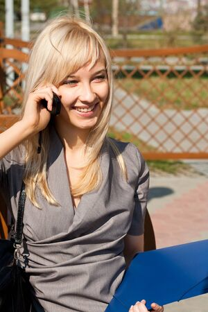 Picture of talking to phone businesswoman photo