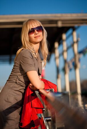 Young blond woman relaxing in the sun Stock Photo - 6967610