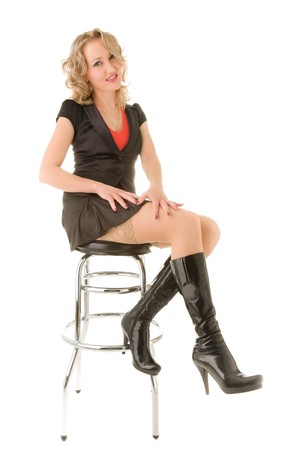 Beautiful blond woman sitting on the bar chair Stock Photo - 6967561