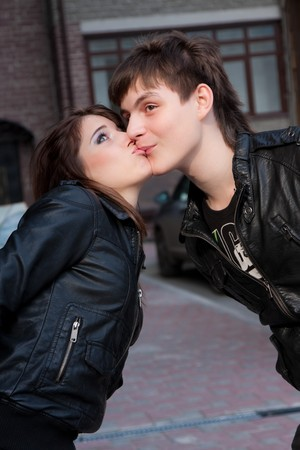 Picture of kissing funny couple outdoors photo