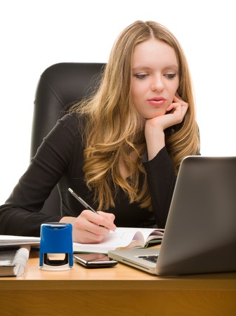 appointee: Young businesswoman writting in notebook and looking to the laptop
