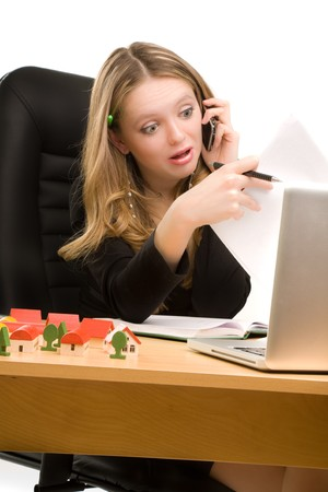 Tired businesswoman with telephone and a sheet of paper in her hands sitting Stock Photo - 7011961