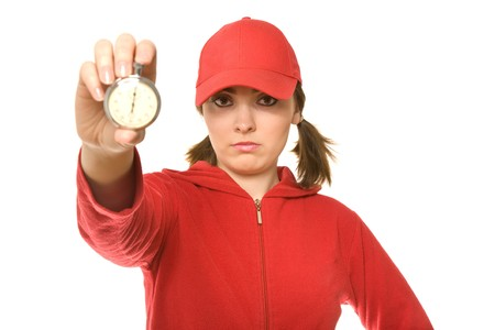Coach holding a  stopwatch in her hands (focus on coach)