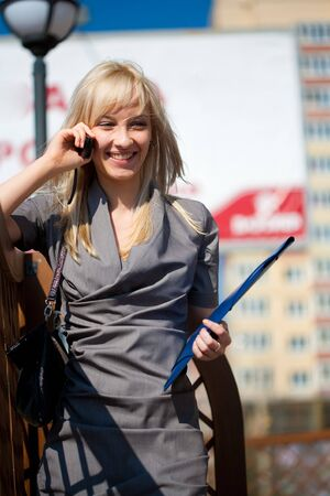 Woman calling on mobilephone outdoors photo