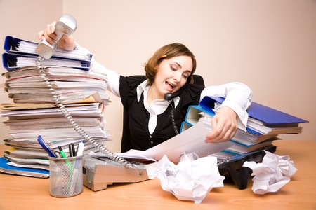 appointee: Young businesswoman with tons of documents calling phone Stock Photo