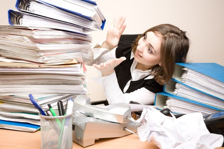 appointee: Young businesswoman with tons of documents screaming Stock Photo