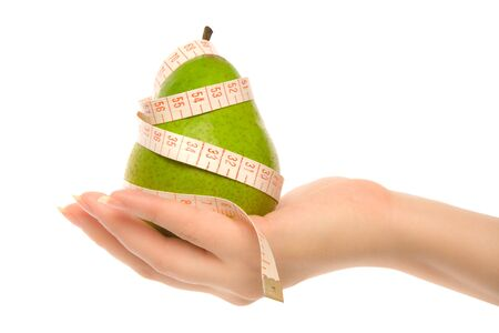 womans: Womans hand holding green pear Stock Photo