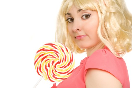 Picture of beautiful blond woman with lollipop (focus on face) photo