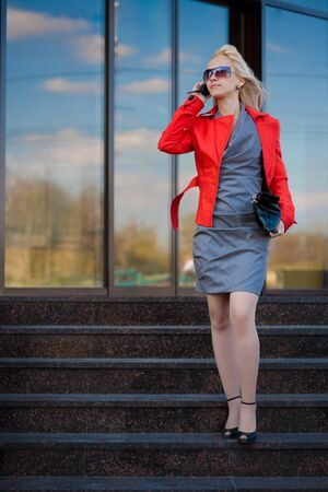 Businesswoman in grey dress being late Stock Photo - 7087479