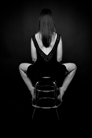 Woman's back  sitting on the barchair Stock Photo - 7271402
