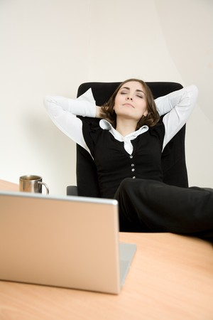 appointee: Young businesswoman sitting in the chair and dreaming Stock Photo