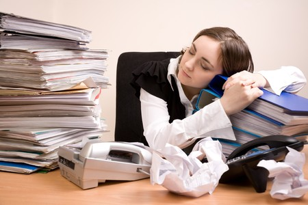 Young secretary with a lot of folders sleeping Stock Photo - 7271445
