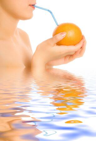 Woman drinking from orange photo