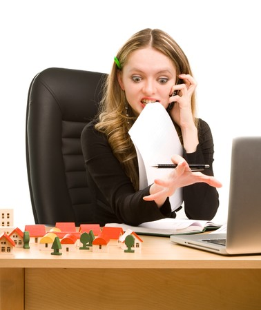 Tired businesswoman with telephone and a sheet of paper in her mouth sitting Stock Photo - 7271403
