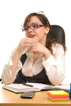 Young businesswoman with notebook in the office photo