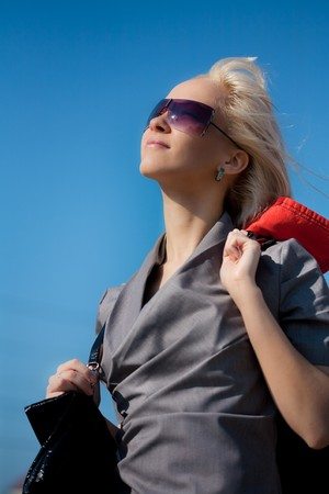 Woman with sunglasses dreaming outdoors Stock Photo - 7271429