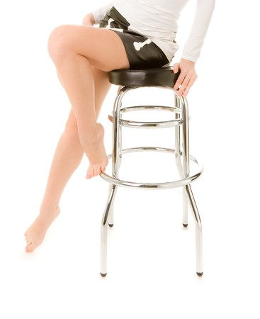 Woman's legs barefoot with bar chair on the white background Stock Photo - 7273731