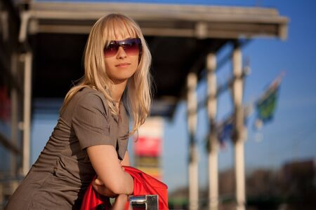 Young blond woman relaxing in the sun Stock Photo - 7271432