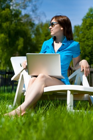Businesswoman with laptop outdoors Stock Photo - 7271427