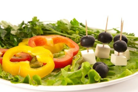 A plate of cut pepper, feta cheese, olives and lettuce photo
