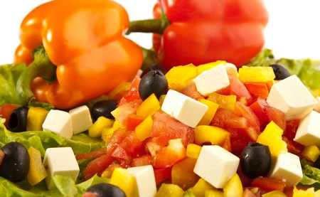 Greek salad with two colorful peppers closeups photo