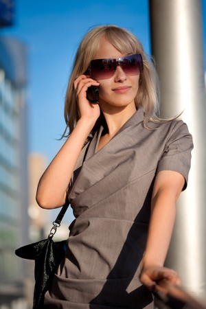 Beautiful woman calling to cellphone outdoors Stock Photo - 7356448