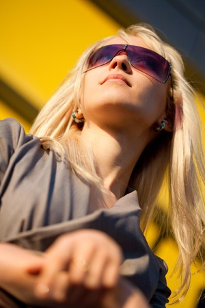 Beautiful yong woman with sunglasses thinking photo