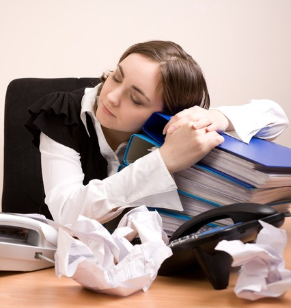 appointee: Young secretary with a lot of folders sleeping