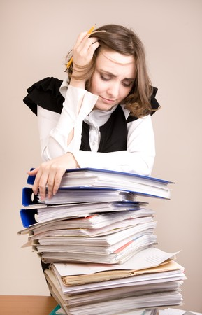 appointee: Tired secretary with a lot of documents Stock Photo