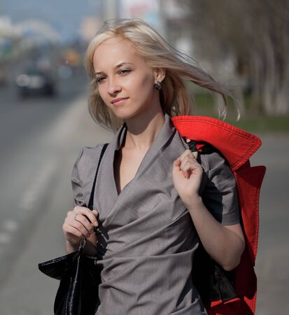 Young woman walking on a city street photo