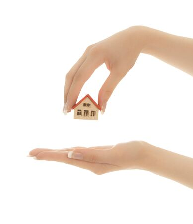 Woman's hands holding a toy house and keys isolated Stock Photo - 7383518