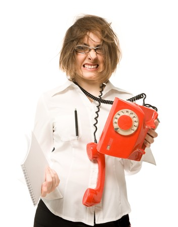 Nervous businesswoman with telephone and notebook photo