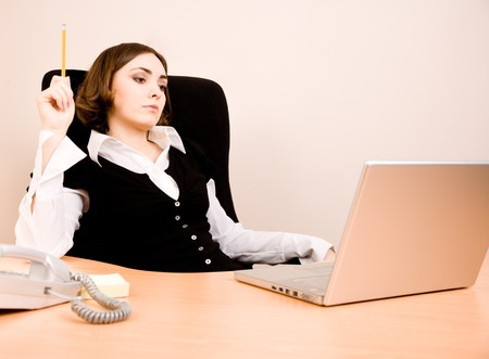Young businesswoman sitting in the chair and thinking Stock Photo - 7372462