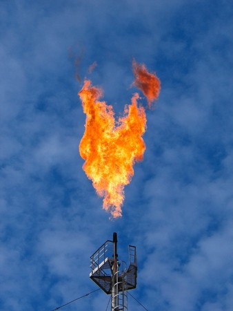 gas supply: Burning oil gas flare over the blue sky Stock Photo