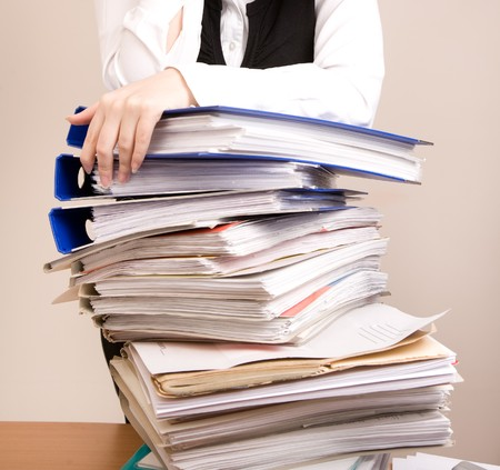 appointee: Secretary with a lot of documents at office