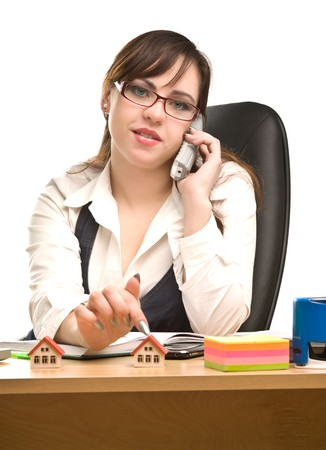 appointee: Beautiful businesswoman calling by  phone and looking to the camera