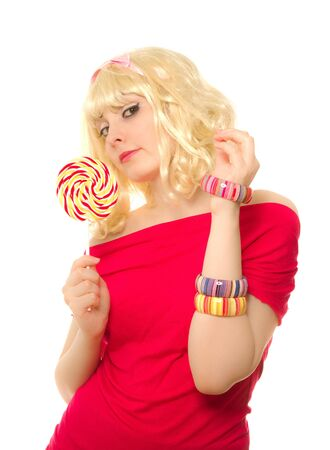 Blond woman in wig with lollipop photo