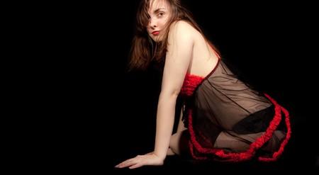 Sexy girl sitting on the floor in underwear photo