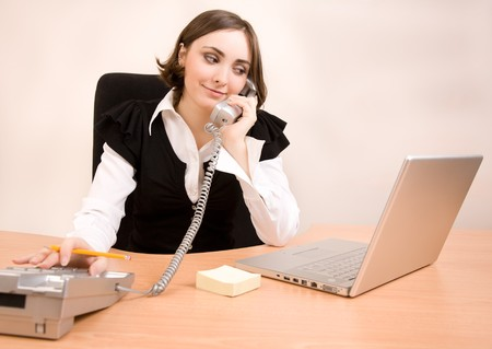 appointee: Businesswoman calling by phone in office Stock Photo