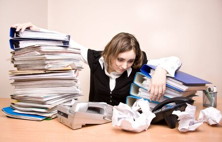 Young businesswoman with tons of documents at office Stock Photo - 7489470