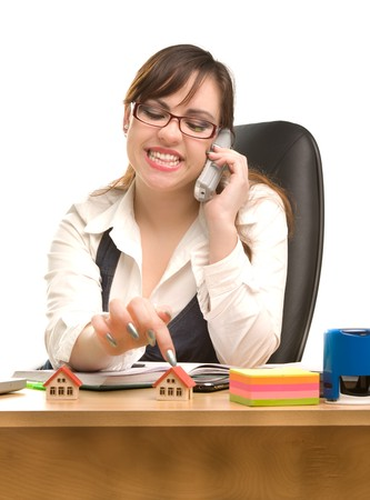 appointee: Beautiful businesswoman calling by phone at office