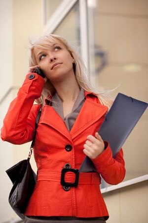 Businesswoman calling by phone outdoors photo